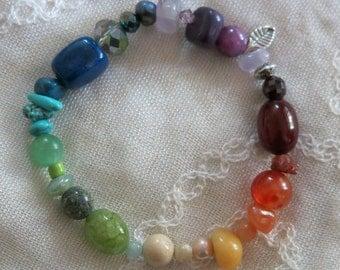 Handmade bracelet in a rainbow of semi-precious gems with garnet, Swarovski crystal, freshwater pearl, amethyst, carnelian, aventurine