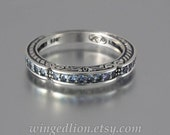 CARYATID wedding band in sterling silver with Alexandrites