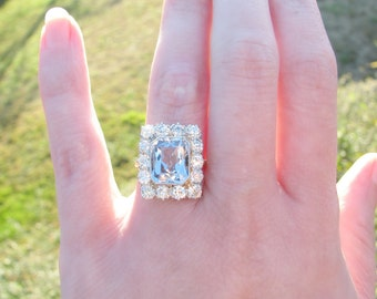 Antique Diamond Halo Ring with Icy Blue Spinel and European Cut Diamonds, approx 3.54 ctw, Platinum and 18K, Circa 1910