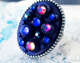 fantastic planet ring with cobalt blue oval cab and rhinestones