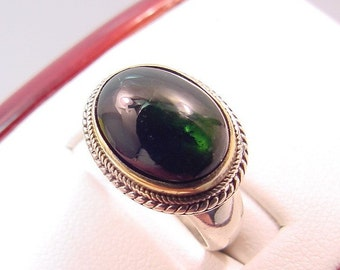 Stunning Vivid green TOURMALINE 14x10mm 6.88 CaratS in a sterling silver ring with 18K yellow gold bezel 0169 y