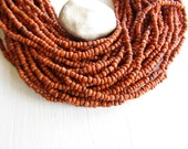 orange seed  beads , opaque orange glass beads,  rustic color small organic barrel tube Indonesian 1.5  to 4  mm / 44 inches  strand 6bb5 -9