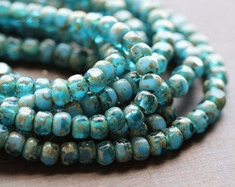 BEACHY TEAL SEEDS .. 50 Picasso Czech Glass Tri-Cut Seed Bead Size 6/0 (5258-st)