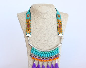 SIBUNDOY ethnic statement necklace with beaded strap, turquoise and marigold beads and purple tassels