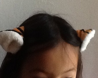 Clip on tiger ear and tail package