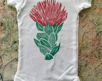Baby Onesie, White, with Red and Green ʻŌhiʻa Lehua Blossom block print, Six (6) or Twelve (12) Month Sizes