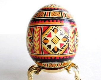 Orange Pysanka, Ukrainian Easter egg, batik decorated chicken egg
