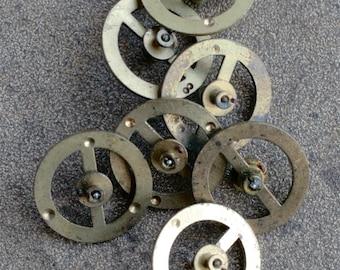 Vintage clock brass balance wheels -- set of 7 -- D2