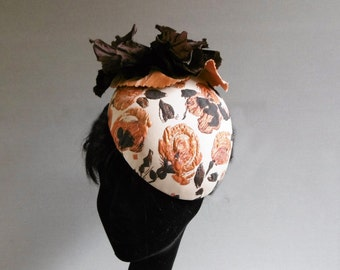 orange bronze and creme hat with ton sur ton flower on comb