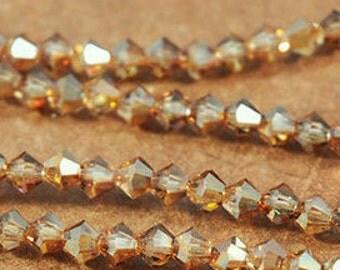 4mm Crystal Venus from Preciosa Czech Crystal - Varying Shades of Dark Amber & Topaz - 31 Beads - FULL STRAND - Bicone