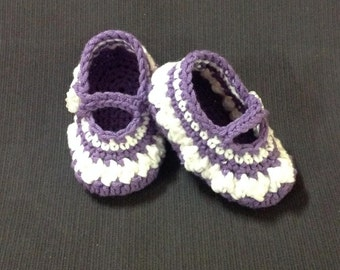 Crocheted Mary Jane baby shoes  purple and white in colour.