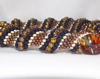 Handcrafted Cellini Spiral Bracelet - seed bead bracelet spiral Bracelet in Blue, browns, and white