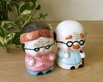 Vintage Porcelain Coin Bank of Japanese Old Man and Woman Figurines