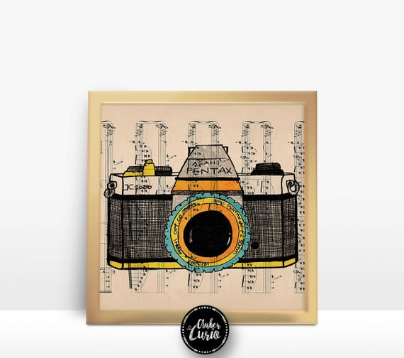 Karl Addison Pentax Multi-Color Camera Print on an Unframed Upcycled Bookpage