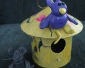 Sing a Song of Spring Time a 6 inch paper mache bird house with 3 inch clay mouse and 3 inch clay bird on the roof