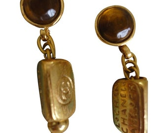 Vintage CHANEL golden dangling stud, pierced earrings with round brown gripoix stone and triangle shape CC and logo charm. Great gift