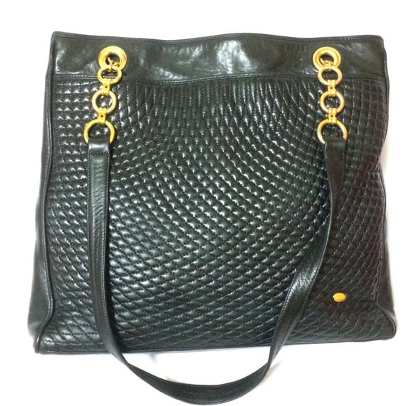 Vintage Bally classic black quilted leather large shopper tote bag with golden hoop chains and round logo plate.