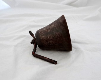 Vintage metal bell with mounting bracket
