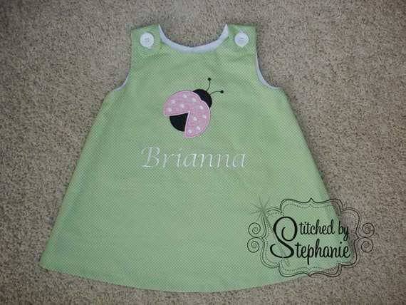 Baby or toddler girls embroidered pink ladybug applique personalized with name monogrammed green jumper dress