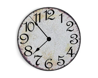 White wall clock with speckles.  Circle design.