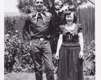 Antique Snapshot Photo of a Anthony Bourdain Lookalike Dressed as Cowboy With Asian Women