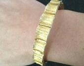 sweet little gold florentine finish bangle bracelet