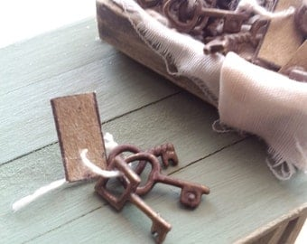 1/12th scale rusty old set of keys with brown tag on string (one set)