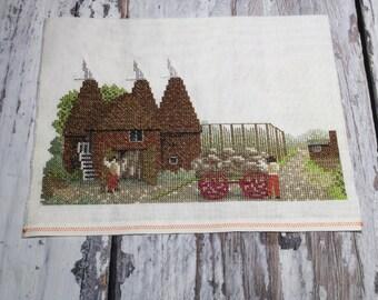 Finished cross stitch . Completed x stitch . Oast house cross stitch . Unframed wall decor .