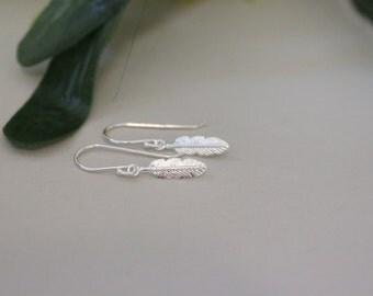 Sterling silver feather earrings, tiny dangle earrings, simple earrings, rememberance, charm earirngs, children earrings, everyday jewelry