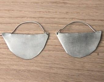 decent silver hoop earrings. artisan made hoops. freeform archaic earrings