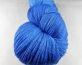 Police Box:  875 yards 80/20 Merino wool/silk yarn in Celestial yarn base.