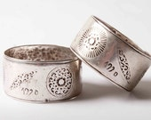 A rare matching pair of stunning Moroccan silver cuff bracelets with rose and sun symbols dated 1920