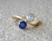 Antique Art Nouveau Edwardian Sapphire Diamond Toi et Moi 18k Gold Engagement Ring with Twist Bypass Design
