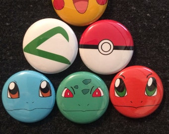 Pokemon inspired 1 inch pins! Perfect for park bags, lanyards, and jackets!