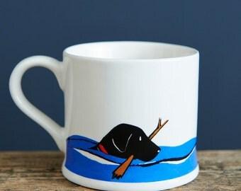 Swimming Black Labrador mug