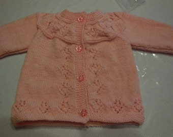 JOLI overlap layette knitted hand colour pale pink - days at the bottom, front, sleeves and yoke.