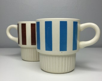 two vintage USA Pottery blue and brown striped stacking mugs