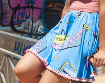 Highway Bliss | mini skater pattern print skirt in pastel colors with pink pom pom finish