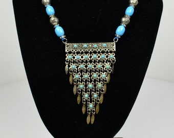 Multi stranded beaded pendant necklace