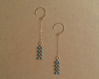 Golden earrings (14 k gold finishes) blue grey ears