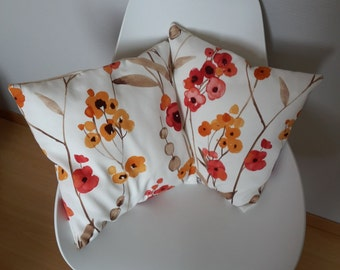 Pillow cover with orange and red poppies on beige background patterns