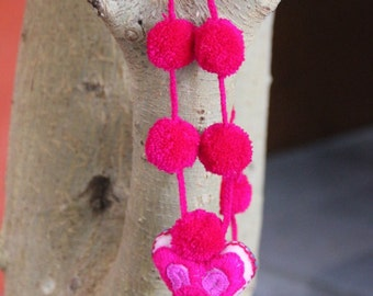Fabric heart with pompons, pink