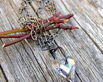 SALE. swarovski crystal heart, moonstone gem and gunmetal pendant necklace. dainty necklace. ice blue wild heart.