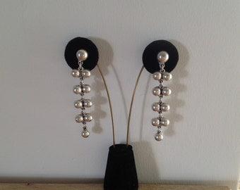 Sterling Silver pierced dangling earrings