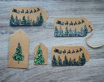 Set of Christmas gift tags. Green glitter. Assorted sizes. Christmas holiday tags. Christmas tree. Santa. Modern contemporary.  Kraft card.