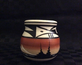 Handmade and signed small pottery pot.