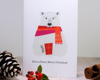 Polar Bear A6 Christmas Card, Bear wearing a scarf holding a present, Arctic Merry Xmas Card, Snuggly Festive Polar Bear