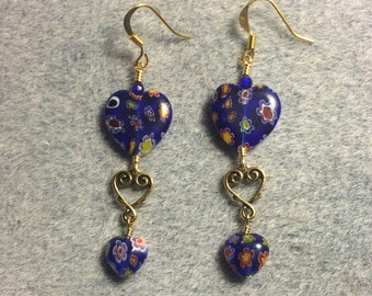 Large and small matching dark blue millefiori heart bead dangle earrings joined by a gold Tierracast heart connector charm.