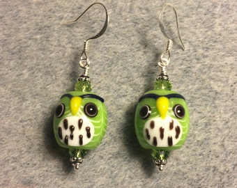 Lime green and white spotted lampwork owl bead earrings adorned with lime green Chinese crystal beads.