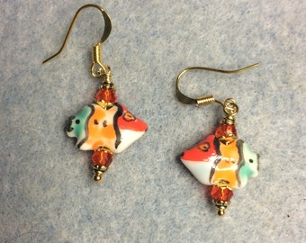 Tiny red, orange and turquoise ceramic fish bead earrings adorned with orange Chinese crystal beads.